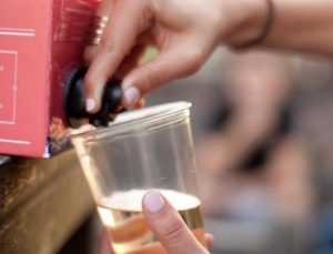 Sustainability | Bagged wine begin poured into a cup.